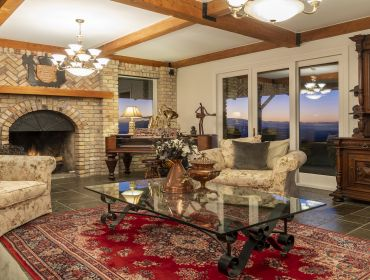 The Homestead Event and Wedding Venue, Eagle Ridge Country Estate, rustic lounge, exposed brick fireplace